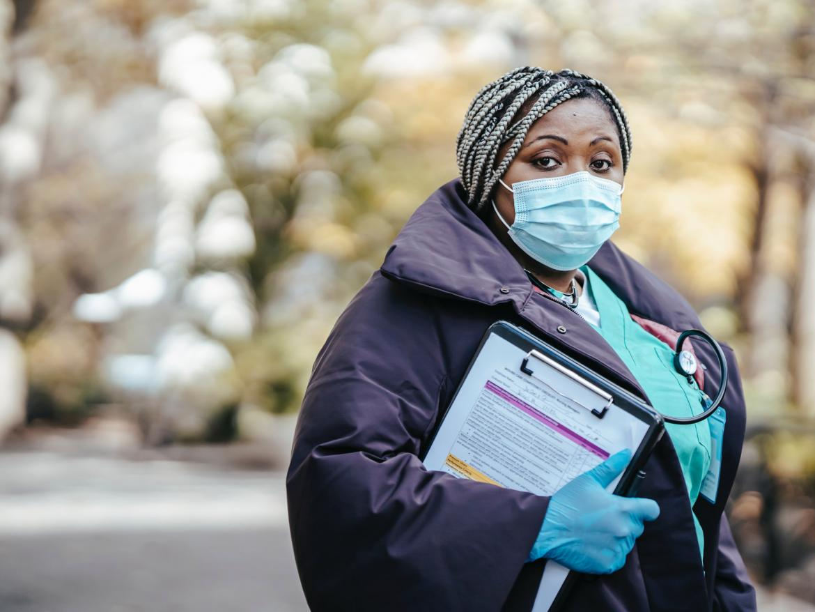 Nurse at outdoor intake center during COVID-19 pandemic