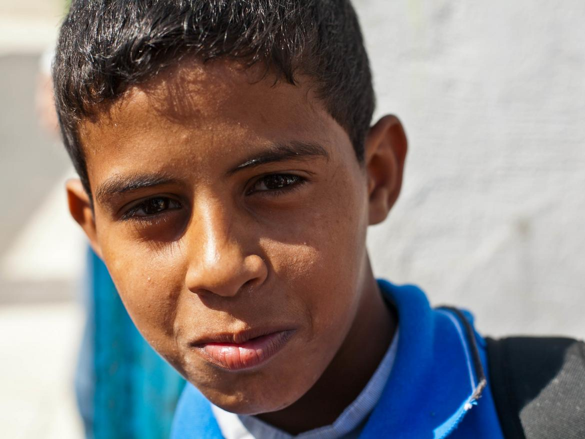 A Palestinian boy poses for a photo after school in Jarash refugee camp about an hour north of Amman in Jordan.