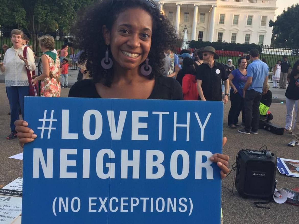Lauren Brownlee holding Love Thy Neighbor sign at White House
