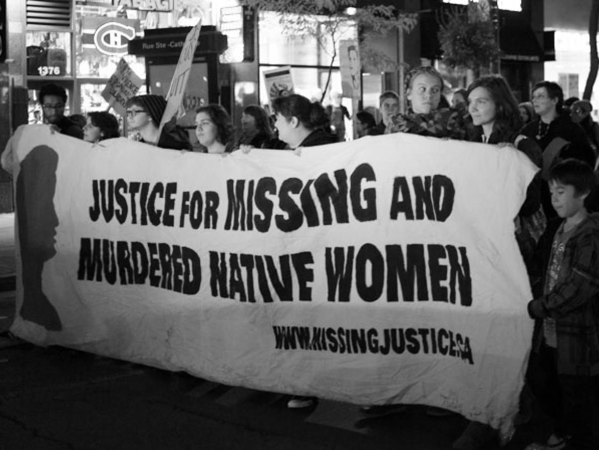 "Marchers carrying a sign that says ""Justice for Missing and Murdered Native Women"""