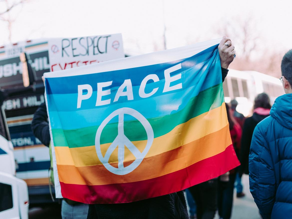 Person carrying peace flag