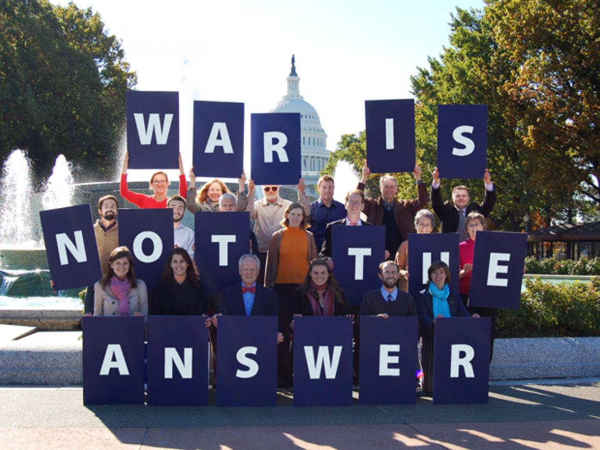 "Advocates hold letters that spell out ""War is Not the Answer"" in front of U.S. Capitol"