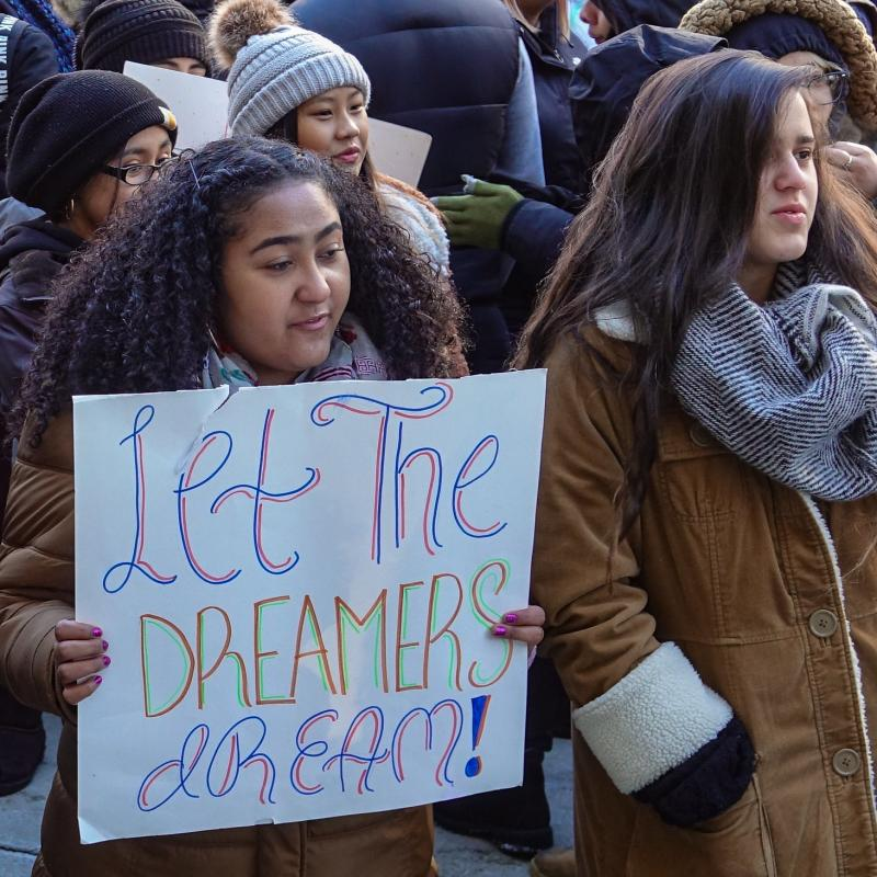 "Marchers at DACA rally hold sign that says ""let the dreamers dream!"""