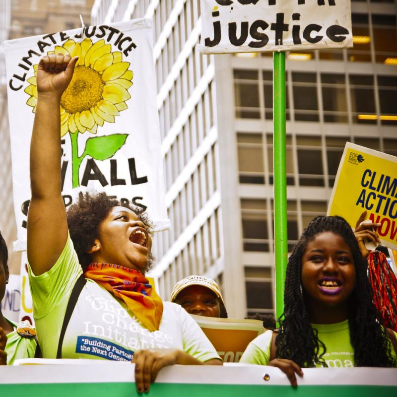 Marchers at the People's Climate march call for  Joe Brusky Climate Justice for All