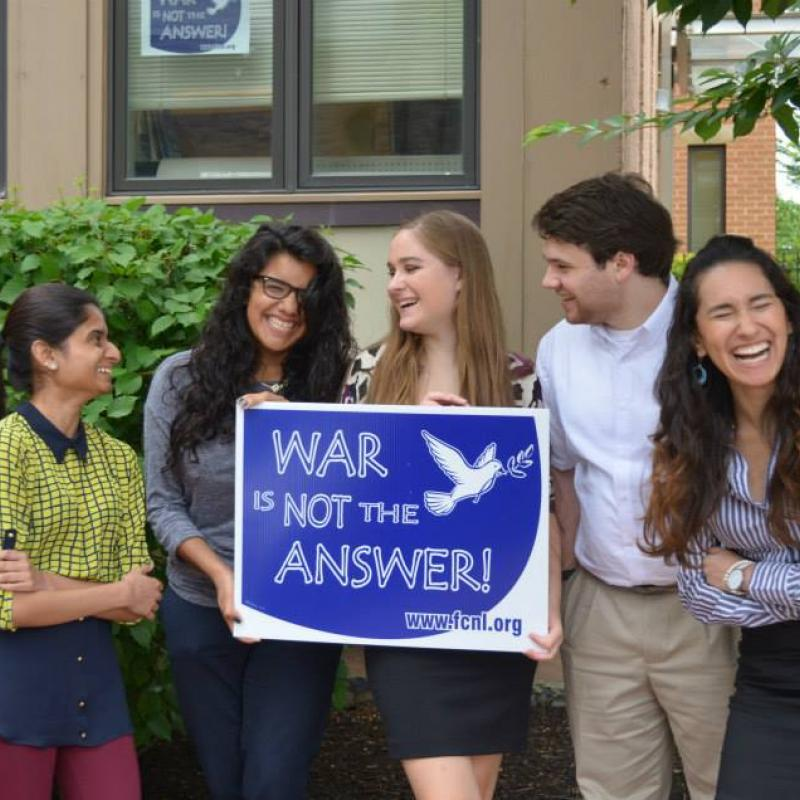 Interns hold a War Is Not the Answer sign