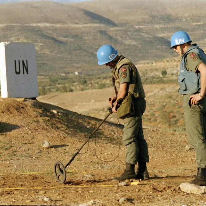 UN workers removing landmines.