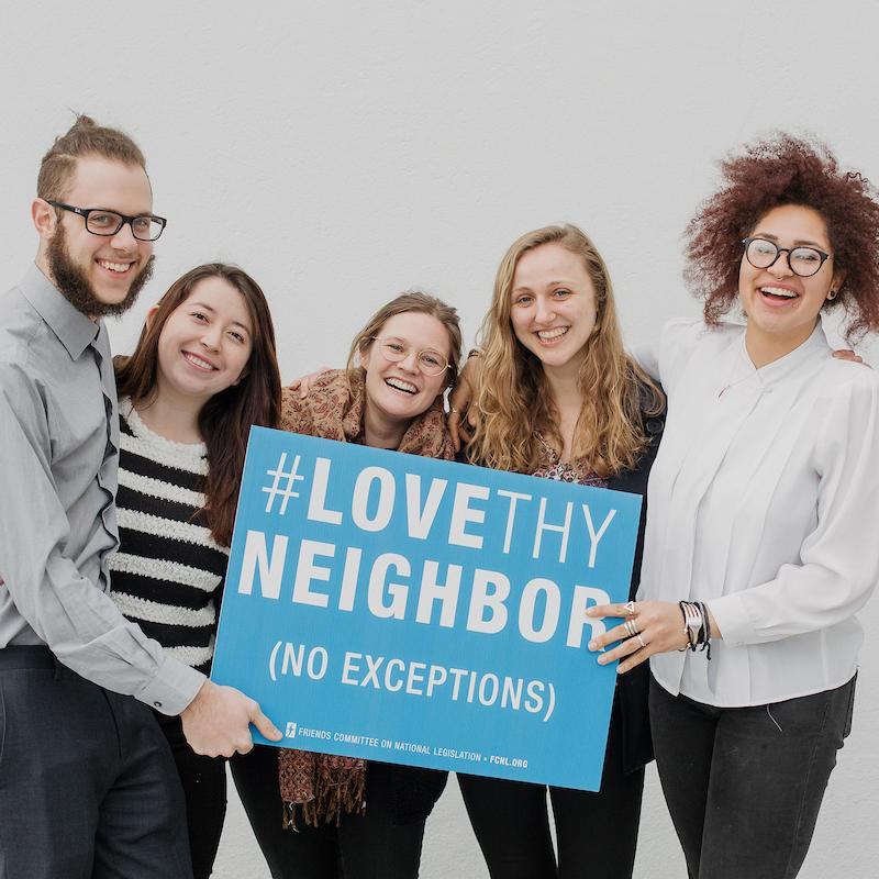 Spring Lobby Weekend Participants Holding Love They Neighbor Sign