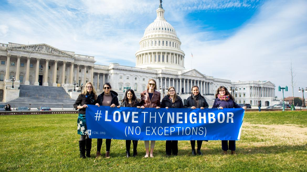 FCNL staff and partners at the capitol building with LoveThyNeighbor banner.