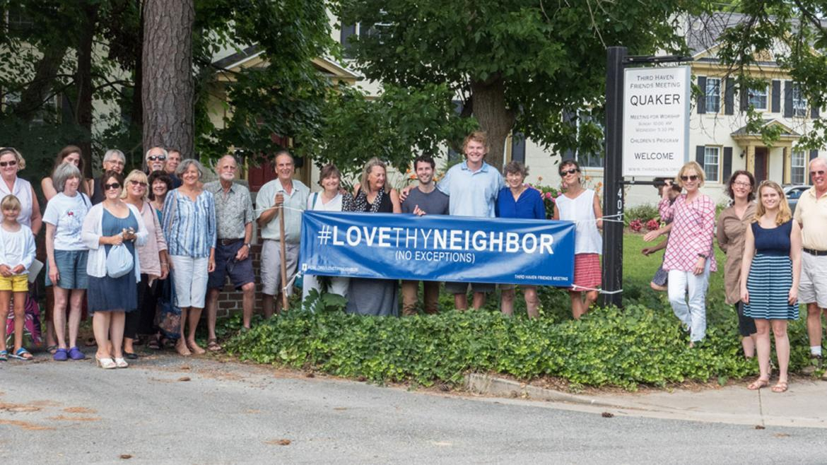 Third Haven Friends Meeting holds a sign that says Love Thy Neighbor